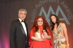 Shahnaz Husain being conferred the Woman of the Year Gold Award by Lord Dolar Popat (left) and Simrin Choudhrie, Chairperson and Director of Path to Success (right)