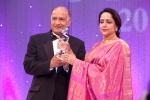 Hema Malini being conferred the International Personality of the Year Award by C. B. Patel, Publisher/Editor of Asian Voice and Gujarat Samachar